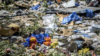 Toys are pictured amongst the wreckage at the crash site of the Malaysia Airlines flight MH17 near the village of Grabove, in the region of Donetsk on July 20, 2014. The missile system used to shoot down a Malaysian airliner was handed to pro-Russian separatists in Ukraine by Moscow, the top US diplomat said Sunday. Outraged world leaders have demanded Russia's immediate cooperation in a prompt and independent probe into the shooting down on July 17 of flight MH17 with 298 people on board. AFP PHOTO/ BULENT KILIC (Photo by BULENT KILIC / AFP)