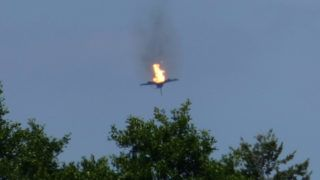 """24 June 2019, Germany (German), Malchow: A burning airplane of the type """"Eurofighter is to be seen in the sky over Malchow. On Monday, the German Air Force confirmed the crash of two """"Eurofighters"""" in Mecklenburg-Western Pomerania after a collision in the air. Both pilots could operate the ejection seat, as the Luftwaffe reported further. Photo: Thomas Steffan/dpa"""