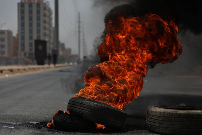 KHARTOUM, SUDAN - JUNE 03 : Sudanese protesters burn tyres and set up barricades on roads to army headquarters after the intervention of Sudanese army, during a demonstration in Khartoum, Sudan on June 3, 2019. At least 13 protesters were killed and hundreds injured on Monday as Sudanese security forces moved in to clear the main protest camp near the army headquarters in the capital Khartoum, according to protest organizers.   Mahmoud Hjaj / Anadolu Agency
