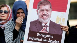 BERLIN, GERMANY - JUNE 18: People attend the funeral prayer in absentia for former President of Egypt Mohamed Morsi, at Pariser Platz, situated by the Brandenburg Gate at the end of the Unter den Linden, in Berlin, Germany on June 18, 2019. Egypt's first democratically-elected president, died during court appearance to face espionage charges. Abdulhamid Hosbas / Anadolu Agency