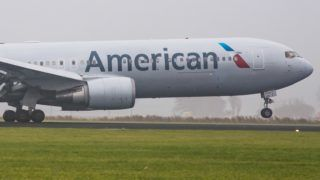 American Airlines Boeing 767-300 landing in the mist in Amsterdam Schiphol International Airport. American connects Amsterdam to Philadelphia and seasonal to Dallas / Fort Worth. The airplane is Boeing 767-323(ER)(WL)  with registration N394AN and is flying for American Airlines since June 1998. American Airlines operates a fleet of 931 airplanes and has on order 243 more. (Photo by Nicolas Economou/NurPhoto)