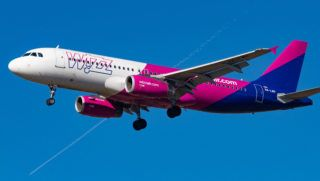 Airbus A320 ( A320-232) aircraft of the low cost airline Wizz Air ( W6 ) with registration landing at Eindhoven EIN EHEH international airport in The Netherlands during the day with nice weather and blue sky.  WizzAir is a budget European airline with headquarters in Budapest, Hungary. (Photo by Nicolas Economou/NurPhoto)