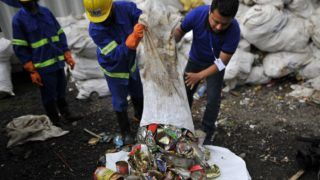 Staff and Workers from the recycle company Blue Waste 2 Value showing the waste garbage's towards media collected from Mount Everest and Base Camp in Kathmandu, Nepal on Wednesday, June 05, 2019. Clean-up Campaign 2019 on Mount Everest removes 24,000lbs of rubbish and four dead bodies. (Photo by Narayan Maharjan/NurPhoto)