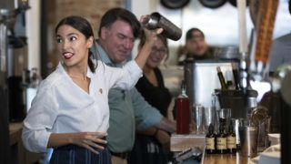 NEW YORK, NY - MAY 31: U.S. Rep. Alexandria Ocasio-Cortez (D-NY) shakes a margarita behind the bar at the Queensboro Restaurant, May 31, 2019 in the Queens borough of New York City. Ocasio-Cortez participated in an event to raise awareness for the One Fair Wage campaign, which calls to raise the minimum wage for tipped workers to a full minimum wage at the federal level.   Drew Angerer/Getty Images/AFP