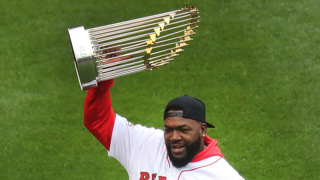 BOSTON - APRIL 9: Former Boston Red Sox player David Ortiz holds up the World Series trophy during pre-game ceremonies. The Boston Red Sox host the Toronto Blue Jays in their home opener for the 2019 MLB season at Fenway Park in Boston on April 9, 2019. (Photo by John Tlumacki/The Boston Globe via Getty Images)