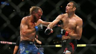 CHICAGO, IL - JUNE 08: Tony Ferguson (R) punches Donald Cerrone (L) at United Center on June 8, 2019 in Chicago, Illinois. (Photo by Rey Del Rio/Getty Images)