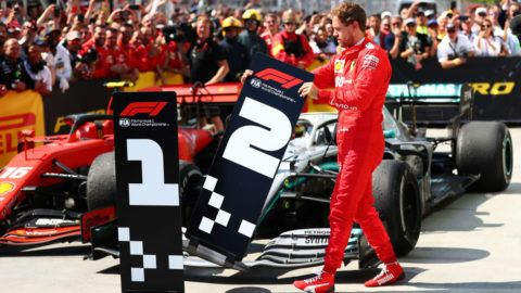 MONTREAL, QC - JUNE 09:  Second placed Sebastian Vettel of Germany and Ferrari swaps the number boards at parc ferme during the F1 Grand Prix of Canada at Circuit Gilles Villeneuve on June 09, 2019 in Montreal, Canada.  (Photo by Dan Istitene/Getty Images)
