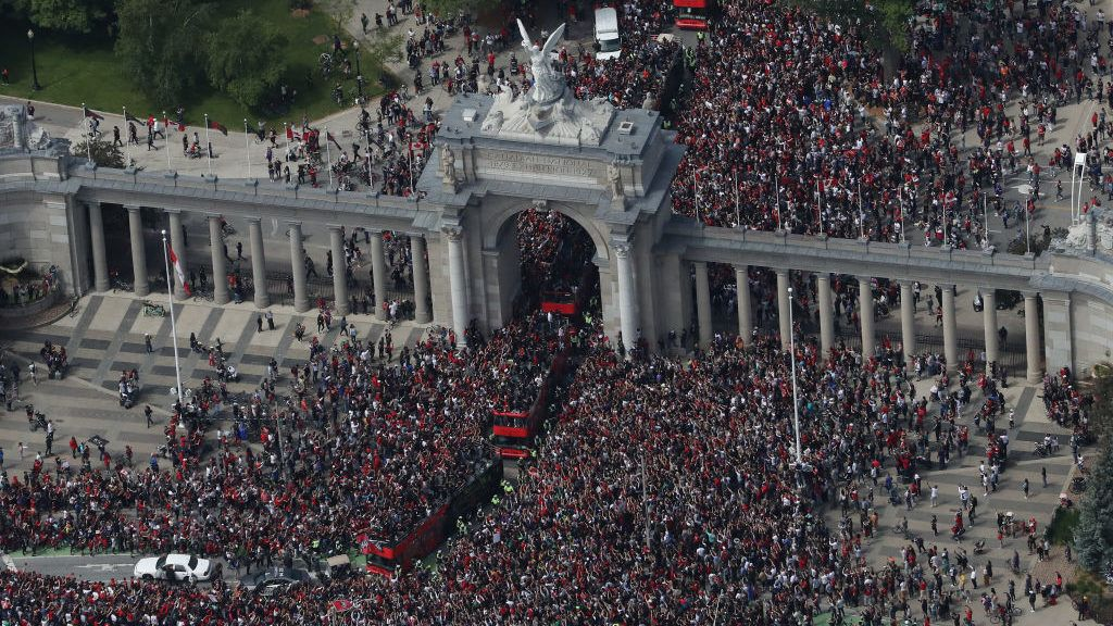 TORONTO, ON - JUNE 17: Fans fill the streets around Princes Gates as they turn out for the Toronto Raptors NBA Championship Victory Parade after defeating the Golden State Warriors in the Finals on June 17, 2019 in Toronto, Canada. NOTE TO USER: User expressly acknowledges and agrees that, by downloading and or using this photograph, User is consenting to the terms and conditions of the Getty Images License Agreement. (Photo by Tom Szczerbowski/Getty Images)