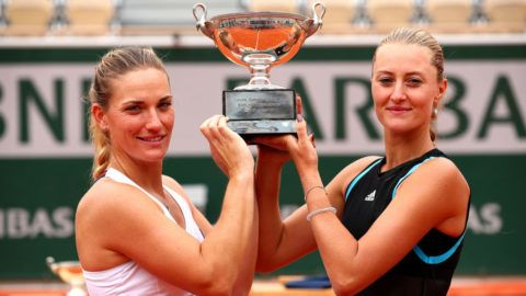 PARIS, FRANCE - JUNE 09: Winners Timea Babos of Hungary and partner Kristina Mladenovic of France celebrate with the trophy following the ladies doubles final against Yingying Duan of China and Saisai Zheng of China during Day fifteen of the 2019 French Open at Roland Garros on June 09, 2019 in Paris, France. (Photo by Clive Brunskill/Getty Images)