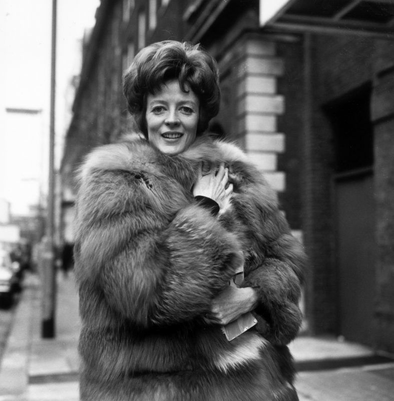 Maggie Smith, British actress, wearing a fur coat as she poses for a portrait, in January 1969. (Photo by Allan Jones/Evening Standard/Getty Images)