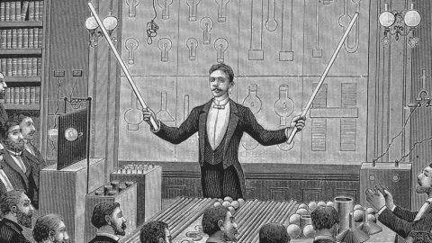 Engraving of Serbian-American inventor Nikola Tesla (1856 - 1943) 'lecturing before the French Physical Society and The International Society of Electricians, circa 1885. (Kean Collection/Getty Images)