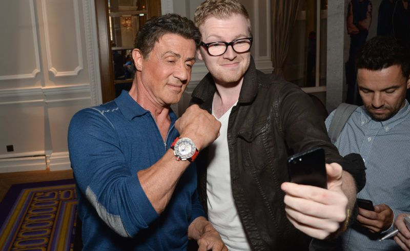 """LONDON, ENGLAND - AUGUST 04:  Sylvester Stallone poses with a fan as he attends """"The Expendables 3"""" press conference at the Corinthia Hotel London on August 4, 2014 in London, England. The Expendables 3 is released on August 14, 2014.  (Photo by Dave J Hogan/Getty Images for Lionsgate)"""