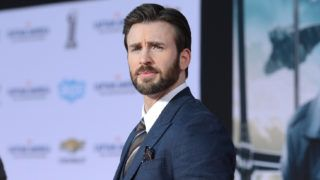 """HOLLYWOOD, CA - MARCH 13:  Actor Chris Evans arrives for the premiere of Marvel's """"Captain America: The Winter Soldier""""  at the El Capitan Theatre on March 13, 2014 in Hollywood, California.  (Photo by Jason Merritt/Getty Images)"""
