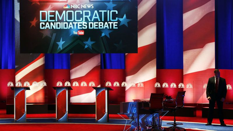 A Secret Service agent stands on stage before the Democratic presidential candidate debate in Charleston, South Carolina, U.S., on Sunday, Jan. 17, 2016. Hours before Sundays Democratic debate, the two top Democratic contenders held a warm-up bout of sorts in multiple separate appearances on political talk shows, at a time when the polling gap between the pair has narrowed in early-voting states. Photographer: Patrick T. Fallon/Bloomberg via Getty Images