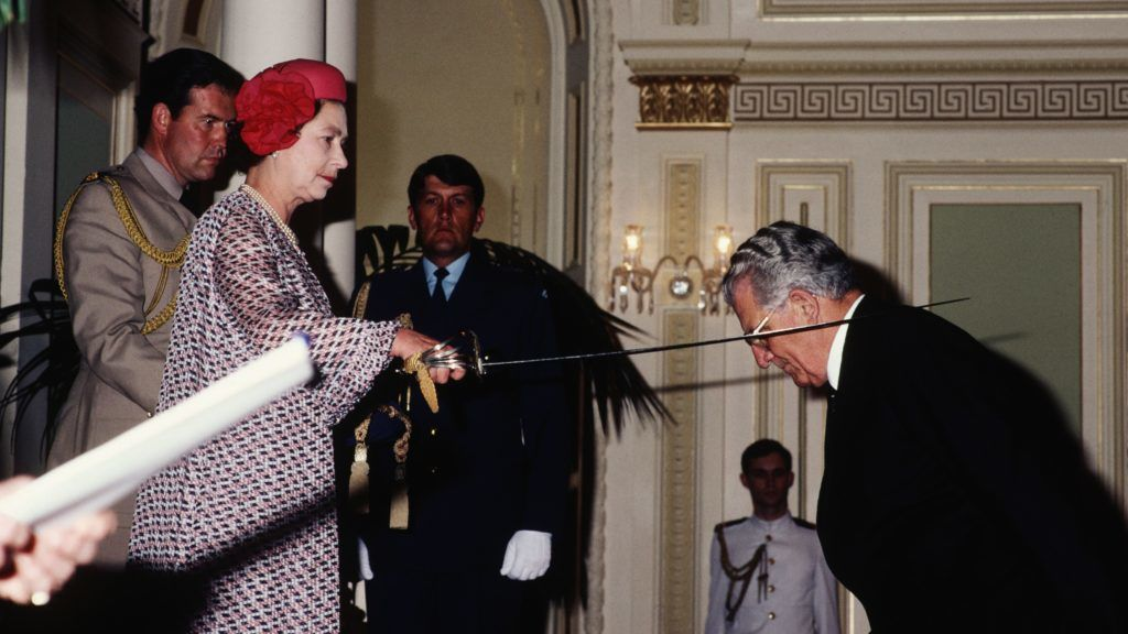 BRISBANE - OCTOBER 8:  Queen Elizabeth II knighting Sir Jack Leggo at an Investiture in Parliament House on October 8, 1982 in Brisbane, Australia during the Royal Tour of Australia. (Photo by David Levenson/Getty Images)