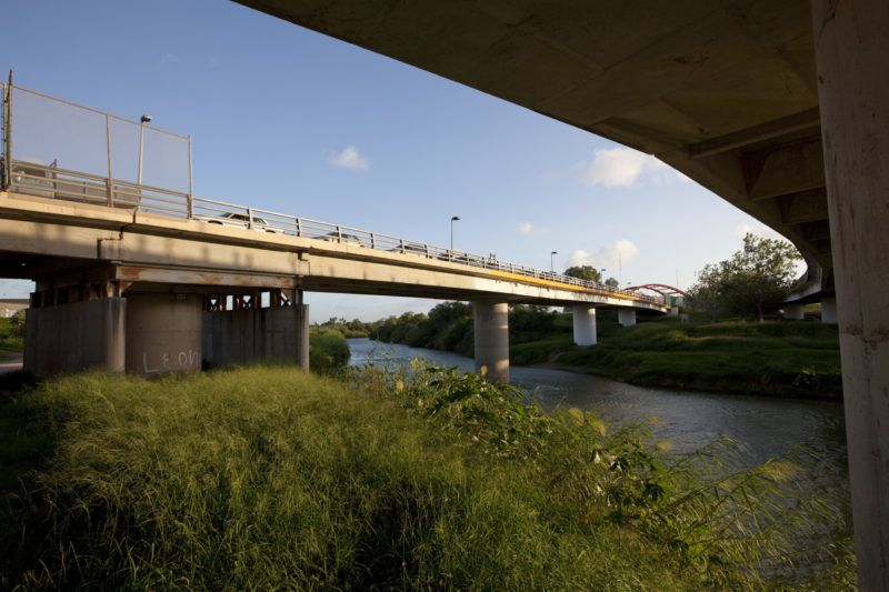 Pedestrians cross into Matamoros, Mexico (R) after shopping in the United States, on one of two international bridges that span the Rio Grande River through downtown Brownsville. (Photo by Robert Daemmrich Photography Inc/Corbis via Getty Images)