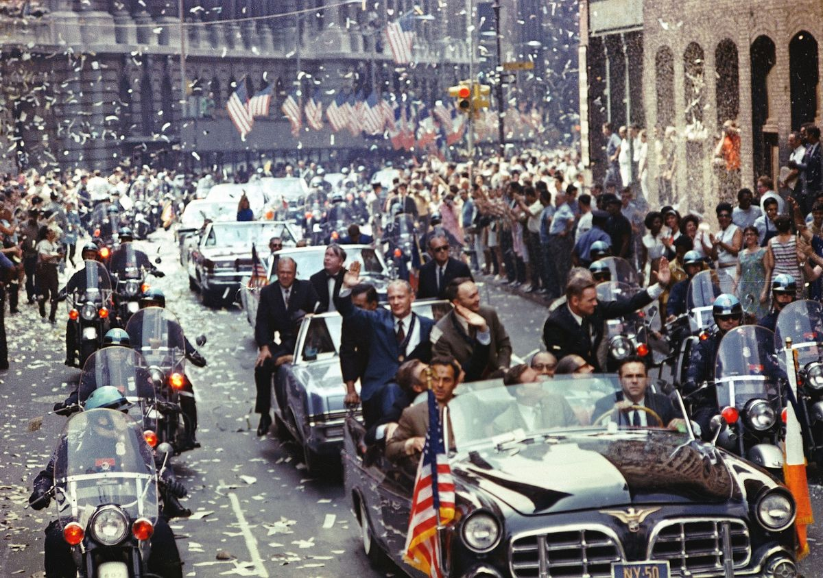 376713 06: (FILE PHOTO) New York City welcomes the Apollo 11 crew in a showering of ticker tape down Broadway and Park Avenue August 13, 1969 in a parade termed as the largest in the city's history. Pictured in the lead car, from the right, are astronauts Neil A. Armstrong, commander; Michael Collins, command module pilot; and Edwin E. Aldrin Jr., lunar module pilot. The three astronauts teamed for the first manned lunar landing on July 20, 1969. The 30th anniversary of the Apollo 11 Moon mission is celebrated July 20, 1999. (Photo by NASA/Newsmakers)