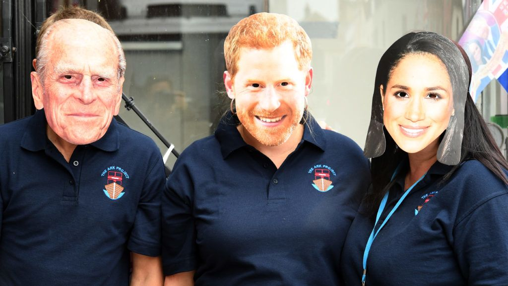 WINDSOR, ENGLAND - MAY 16: Locals wear face masks depicting (left to right) HRH The Duke of Edinburgh, Prince Harry and Meghan Markle near the castle on May 16, 2018 in Windsor, England. Preparations continue in the town for the wedding between Prince Harry and Ms. Meghan Markle on May 19, 2018 when tens of thousands of well wishers will descend on the town just west of London to celebrate the couple's big day.  (Photo by James D. Morgan/Getty Images)