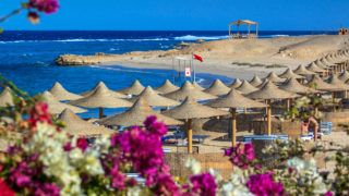 Beach and reef outside Marsa Alam, Red Sea, Egypt.