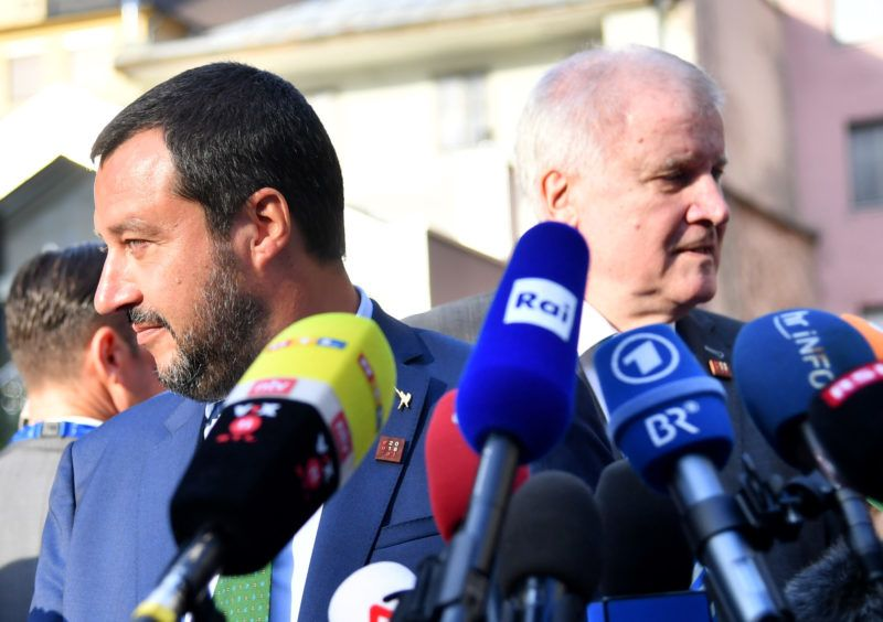 Italian Interior Minister and deputy Prime Minister Matteo Salvini (L) and German Interior Minister Horst Seehofer give a joint press statement following a meeting on July 11, 2018 in Innsbruck, Austria. (Photo by BARBARA GINDL / APA / AFP) / Austria OUT