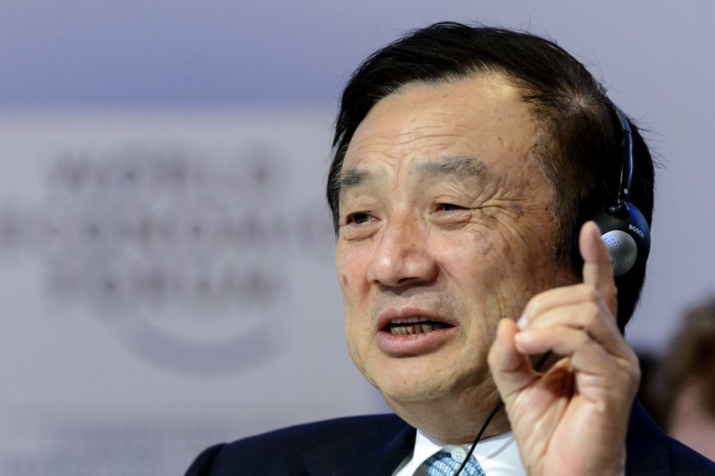 (FILES) This file picture taken on January 22, 2015 shows Huawei Founder and CEO Ren Zhengfei gesturing as he attends a session of the World Economic Forum (WEF) annual meeting in Davos. - Huawei founder Ren Zhengfei on May 21, 2019 shrugged off US attempts to block his company's global ambitions, saying the United States underestimates the telecom giant as it is ready to withstand the impact. (Photo by FABRICE COFFRINI / AFP)