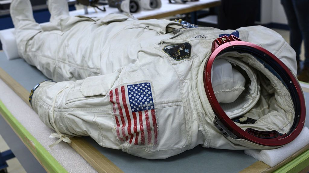 """Lunar Mission Apollo 11 Command Module Pilot Michael Collins' Space suit is seen inside the Conservation Laboratory of the Air and Space Museum in Chantilly, near Washington, on June 28, 2019. - July 20, 2019, will mark 50 years since Commander Neil Armstrong's first step on the moon and the famous phrase """"That's one small step for man, one giant leap for mankind"""". (Photo by Eric BARADAT / AFP)"""
