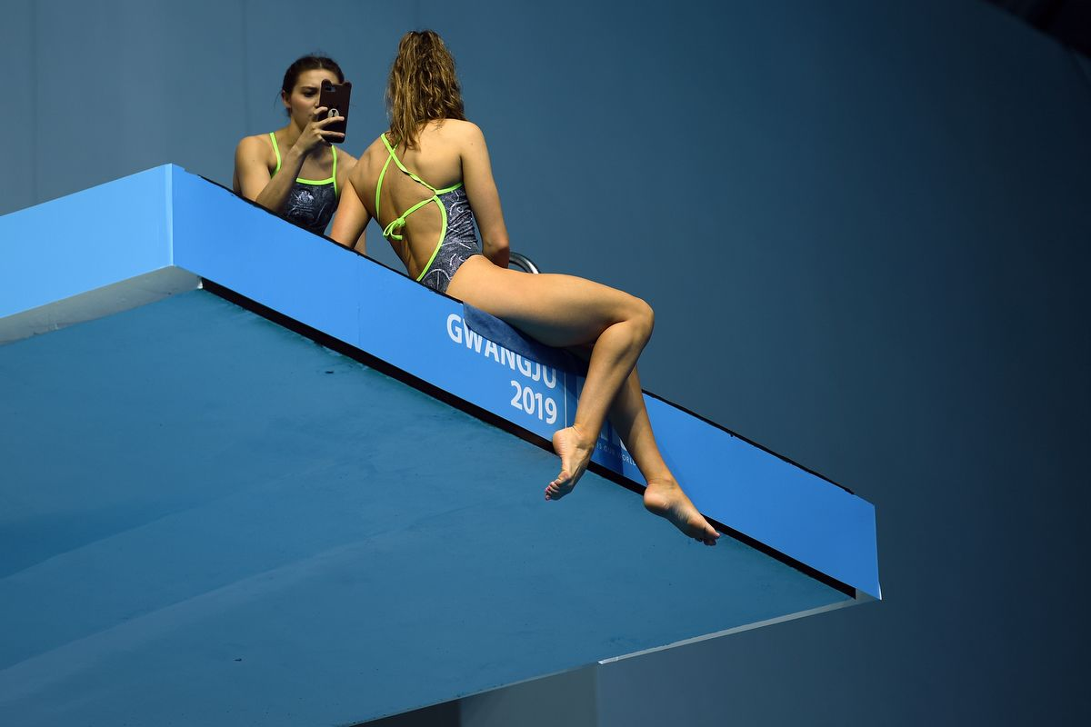 An australian competitor poses for a selfie on a diving platform during the 2019 World Championships at Nambu University Municipal Aquatics Center in Gwangju, South Korea, on July 20, 2019. (Photo by Oli SCARFF / AFP)