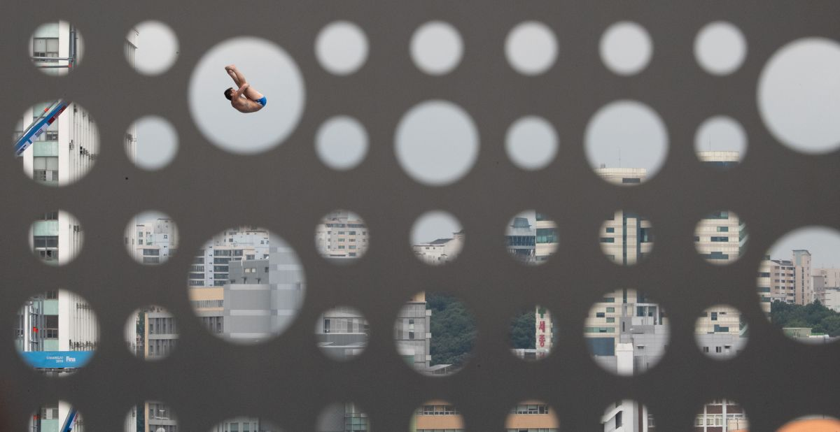 USA's Steve Lo Bue takes a practice dive ahead of the men's high diving event during the 2019 World Championships at Chosun University in Gwangju, South Korea, on July 24, 2019. (Photo by Oli SCARFF / AFP)