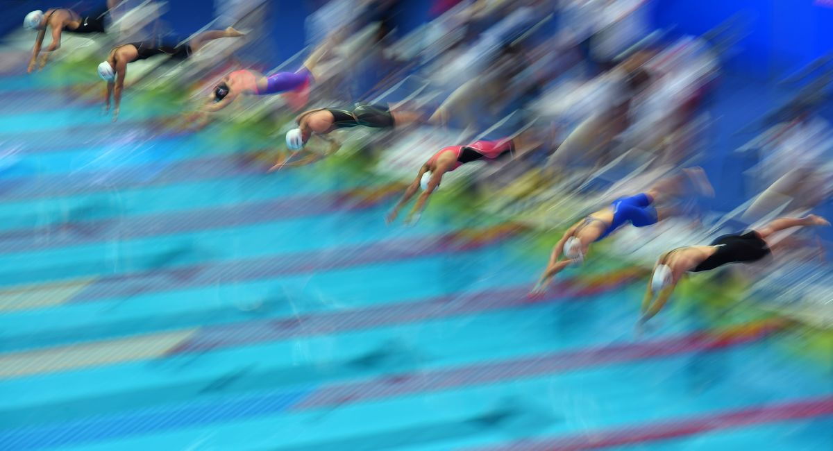 Swimmers compete in a heat for the women's 4x200m freestyle relay event during the swimming competition at the 2019 World Championships at Nambu University Municipal Aquatics Center in Gwangju, South Korea, on July 25, 2019. (Photo by Oli SCARFF / AFP)