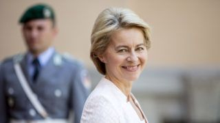 25 June 2019, Berlin: Ursula von der Leyen (CDU), Federal Defence Minister, laughs in front of Villa Borsig on Lake Tegel as she waits for the guests of the Northern Group defence ministers' meeting. Photo: Christoph Soeder/dpa
