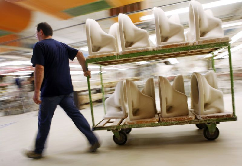 An employee pulls a cart laden with toilets to be glazed at the factory of ceramics manufacturer 'Villeroy & Boch' in Mettlach, Germany, 17 July 2007. The company is named after its founders Francois Boch and Nicolas Villeroy and is still family property after over 250 years. Photo: Frank Rumpenhorst