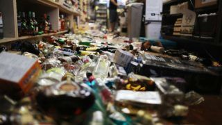 RIDGECREST, CALIFORNIA - JULY 06: An employee works at the cash register near broken bottles scattered on the floor, following a 7.1 magnitude earthquake which struck nearby, on July 6, 2019 in Ridgecrest, California. The earthquake, which occurred July 5th, was the second large earthquake to hit the area in two days and the largest in Southern California in 20 years.   Mario Tama/Getty Images/AFP