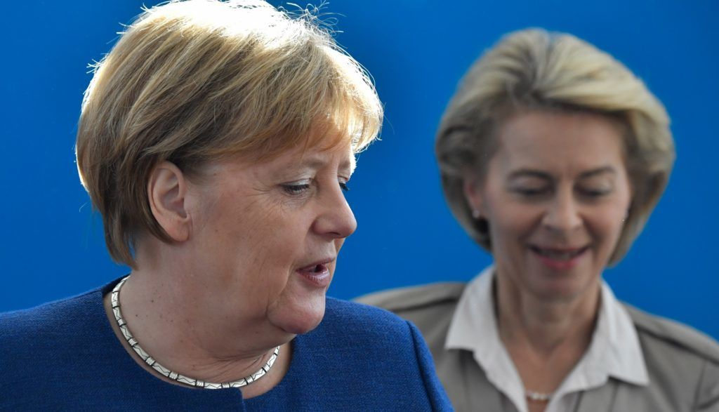 German Chancellor and leader of the Christian Democratic Union (CDU) Angela Merkel (L) and German Defence Minister and Deputy Chairwoman of the Christian Democratic Union (CDU) Ursula von der Leyen arrive for a leadership meeting of the CDU party at their headquarters in Berlin, on October 15, 2018. - German Chancellor Angela Merkel's conservative CSU allies suffered historic losses in Bavaria state elections on October 14, 2018, dealing a blow to her fragile three-party coalition government. The Christian Social Union (CSU) scored 37 percent, a steep 10-point drop from four years ago in the wealthy Alpine state it has ruled almost single-handedly since the 1960s. (Photo by John MACDOUGALL / AFP)