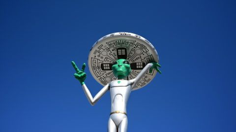 An Alien sculpture lines the side of the road in the town of Baker, California, which claims the world's largest thermometer at 134 feet, and it also known as the 'Gateway to Area 51' on March 4, 2019. - The Alien sculptures are part of the business Alien Fresh Jerky remains a popular spot for a break for drivers going to and from Los Angeles to Las Vegas. (Photo by Frederic J. BROWN / AFP)
