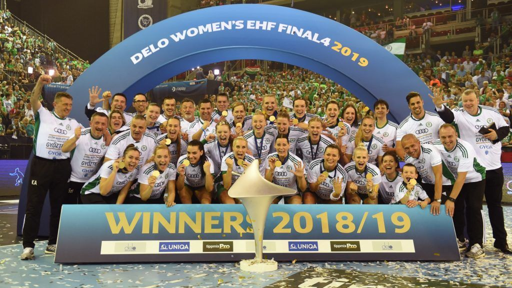 Gyori's players celebrate with the trophy after winning their EHF Women's Champions League Final Four final match between Gyori Audi ETO KC vs Rostov-Don at Papp Laszlo Arena in Budapest on May 12, 2019. (Photo by Attila KISBENEDEK / AFP)