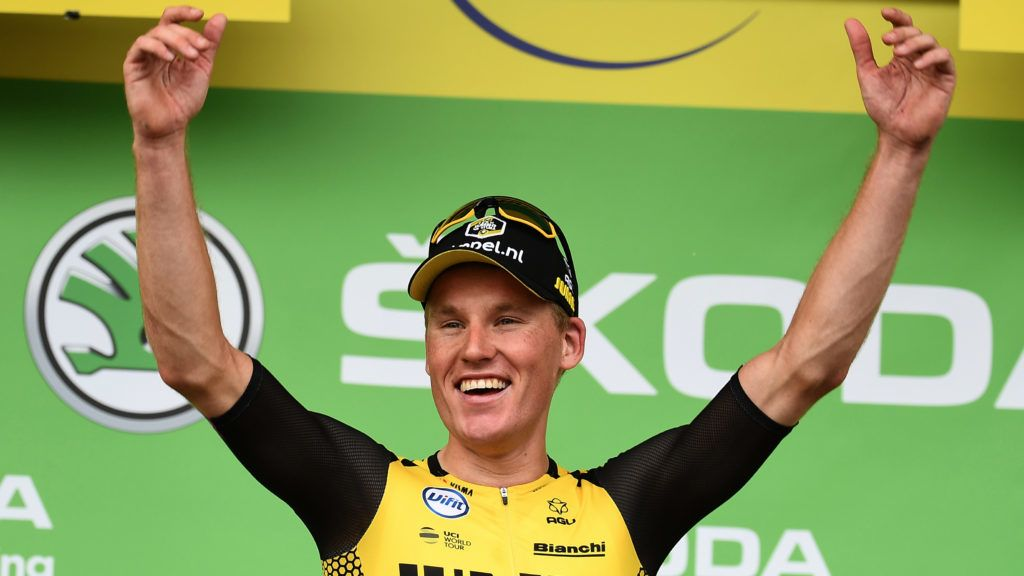 Dutch rider Mike Teunissen celebrates before putting on his best sprinter's green jersey on the podium of the first stage of the 106th edition of the Tour de France cycling race between Brussels and Brussels, Belgium, on July 6, 2019. (Photo by Anne-Christine POUJOULAT / AFP)