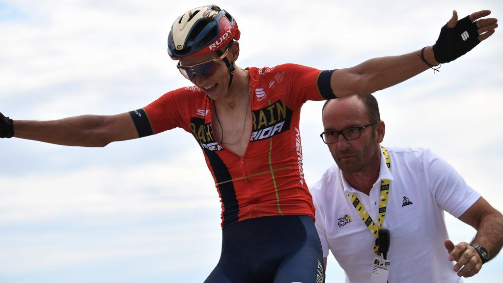 Belgium's Dylan Teuns celebrates as he wins on the finish line of the sixth stage of the 106th edition of the Tour de France cycling race between Mulhouse and La Planche des Belles Filles, in La Planche des Belles Filles on July 11, 2019. (Photo by Anne-Christine POUJOULAT / AFP)