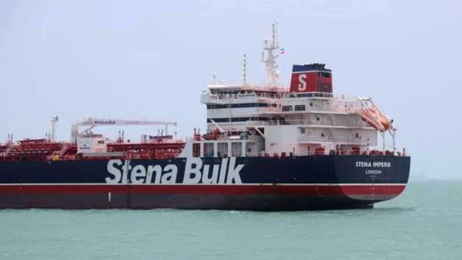 """This handout picture released by Tasnim News Agency on July 20, 2019, shows British-flagged tanker Stena Impero anchored in Bandar Abbas in southern Iran. - A British-flagged tanker seized by Iran is now at anchor off the port of Bandar Abbas with all its crew aboard after colliding with a fishing boat, authorities said on July 20. The Swedish-owned Stena Impero """"collided with a fishing boat"""", said Allah-Morad Afifipoor, director-general of the Hormozgan province port and maritime organisation. (Photo by - / TASNIM NEWS / AFP) / RESTRICTED TO EDITORIAL USE - MANDATORY CREDIT """" AFP / TASNIM NEWS  """" - NO MARKETING NO ADVERTISING CAMPAIGNS - DISTRIBUTED AS A SERVICE TO CLIENTS"""