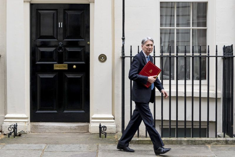 (FILES) In this file photo taken on March 13, 2019 Britain's Chancellor of the Exchequer Philip Hammond leaves from 11 Downing Street in central London. - British finance minister Philip Hammond said July 21, 2019 he would make a point of resigning before Boris Johnson became prime minister, saying he could never agree to his Brexit strategy. (Photo by Niklas HALLE'N / AFP)