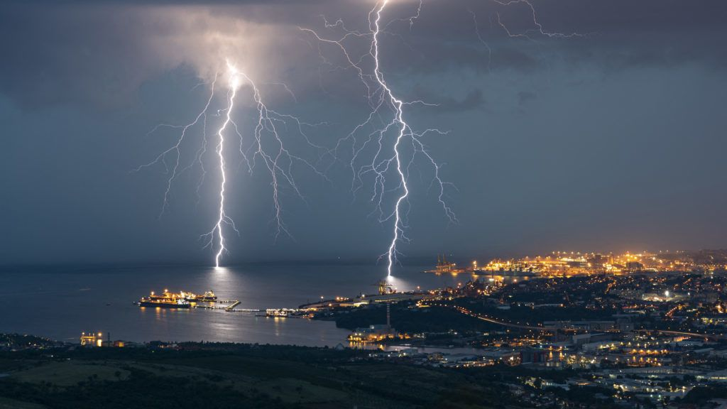 Two branching lightning strikes in Trieste (Italy). Two lightning strikes branched to Trieste, during the very electric storm of August 25, 2018. 