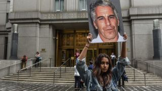 """NEW YORK, NY - JULY 08: A protest group called """"Hot Mess"""" hold up signs of Jeffrey Epstein in front of the federal courthouse on July 8, 2019 in New York City. According to reports, Epstein will be charged with one count of sex trafficking of minors and one count of conspiracy to engage in sex trafficking of minors.   Stephanie Keith/Getty Images/AFP"""
