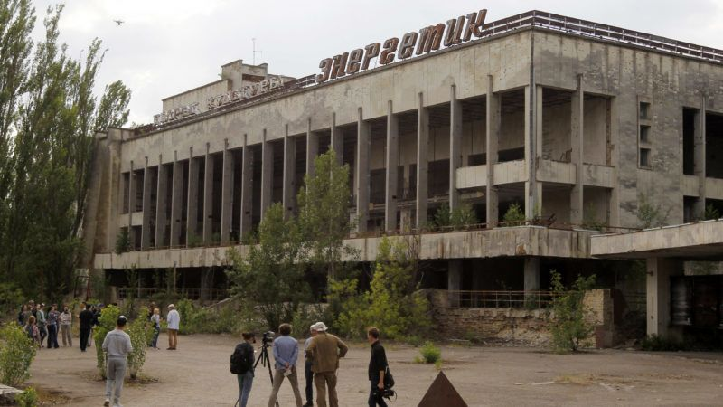Visitors look in the abandoned city of Pripyat, near the Chernobyl nuclear power plant, Ukraine, on 7 June 2019.The Chernobyl Series (HBO) , which depicts the Chernobyl nuclear power disaster's aftermath, including the clean-up operation and subsequent inquiry, drives boom in tourists travelling to see the site of nuclear disaster. Tour agencies have reported up to a 40 per cent increase in bookings since the miniseries aired May 2019. On 2019 Ukraine marked the 33rd anniversary of Chernobyl nuclear disaster. The Chernobyl accident occurred on 26 April 1986 at the Chernobyl Nuclear Power Plant near the city of Pripyat, and regarded the biggest nuclear accident in the history. (Photo by STR/NurPhoto)