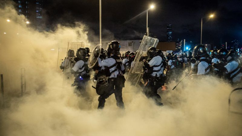 Police Officers are seen walking in tear gas outside Legislative Council in Hong Kong, China. 2 July 2019. Thousands of protesters storm the  Legislative Council Complex on 1 July , the 22th Anniversary of the Handover of Hong Kong From British rule to China.  (Photo by Vernon Yuen/NurPhoto)
