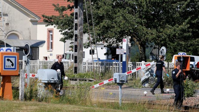 French gendarmes stand at a level crossing on July 15, 2019, after a car and a TER regional express train crashed at the exit of the train station in Avenay-Val-d'Or, near Reims, northeastern France. - A woman and three children died in the accident. (Photo by FRANCOIS NASCIMBENI / AFP)