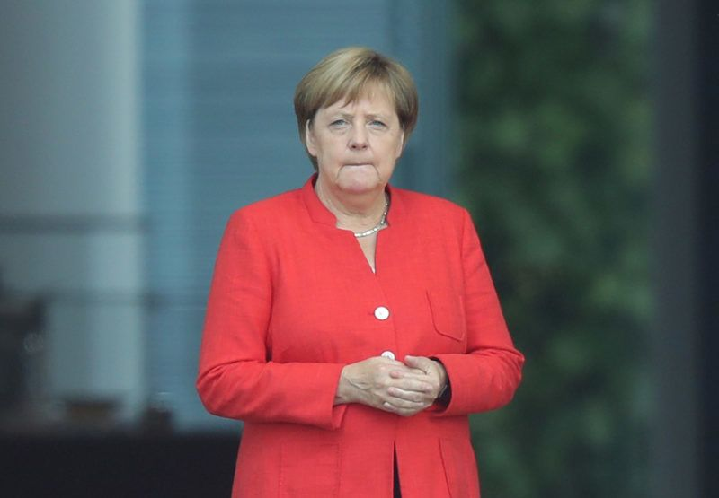 BERLIN, GERMANY - AUGUST 17:  German Chancellor Angela Merkel waits prior to the arrival of Montenegro Prime Minister Dusko Markovic at the Chancellery on August 17, 2018 in Berlin, Germany. In talks scheduled for later in the day the two leaders are scheduled to dicuss Montenegro's bid for joining the European Union, among other topics.  (Photo by Sean Gallup/Getty Images)