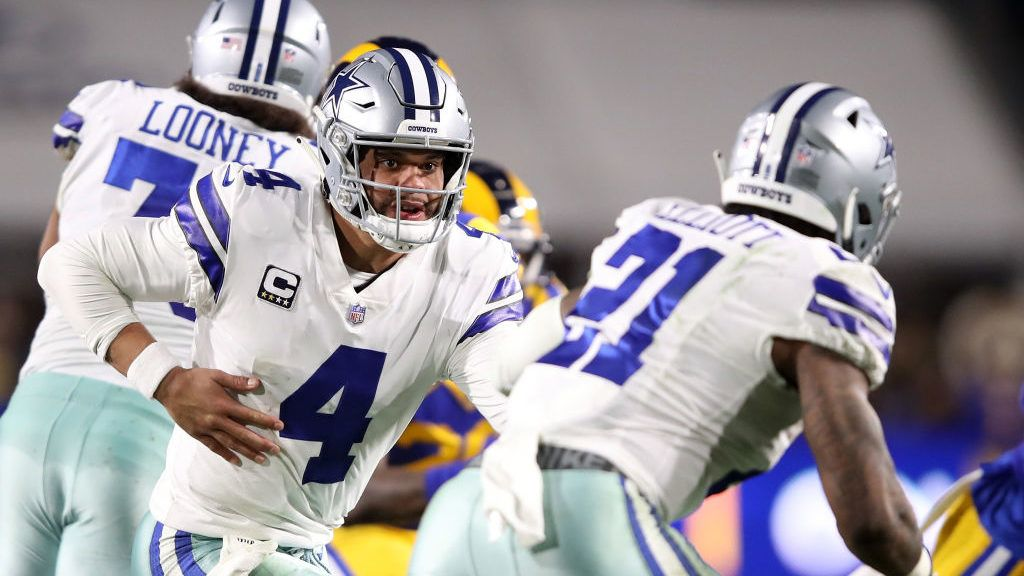 LOS ANGELES, CA - JANUARY 12: Dak Prescott #4 hands the ball off to Ezekiel Elliott #21 of the Dallas Cowboys in the second half against the Los Angeles Rams in the NFC Divisional Playoff game at Los Angeles Memorial Coliseum on January 12, 2019 in Los Angeles, California.  (Photo by Sean M. Haffey/Getty Images)
