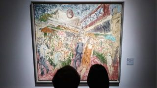 """MOSCOW, RUSSIA  MARCH 4, 2019: A visitor looks at The Flower and Fruit Stalls, Embankment (1995) by British painter Leon Kossoff at an exhibition """"Francis Bacon, Lucian Freud, and the School of London"""" at the Pushkin State Museum of Fine Arts. The exhibition is presented in cooperation with the Tate. Anton Novoderezhkin/TASS (Photo by Anton NovoderezhkinTASS via Getty Images)"""