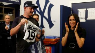 LONDON, ENGLAND - JUNE 29:  Manager Aaron Boone of the New York Yankees presents a gift for Archie to Prince Harry, Duke of Sussex and Meghan, Duchess of Sussex before their game against the  Boston Red Sox at London Stadium on June 29, 2019 in London, England. The game is in support of the Invictus Games Foundation. (Photo by Peter Nicholls - WPA Pool/Getty Images)