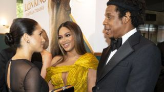"""LONDON, ENGLAND - JULY 14: Meghan, Duchess of Sussex (L) meets cast and crew, including Beyonce Knowles-Carter (C) Jay-Z (R) as she attends the European Premiere of Disney's """"The Lion King"""" at Odeon Luxe Leicester Square on July 14, 2019 in London, England.  (Photo by Niklas Halle'n-WPA Pool/Getty Images)"""