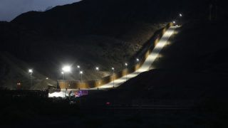 SUNLAND PARK, NEW MEXICO - JUNE 26: A section of border wall put in place by We Build The Wall Inc. stands at dusk on June 26, 2019 in Sunland Park, New Mexico. We Build the Wall is a non-profit organization that is funding the private construction of the section of border wall in an attempt, they say, to stem the flow of migrants and others from coming across the border illegally from Mexico into the United States. (Photo by Mario Tama/Getty Images)